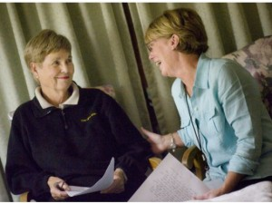 Sara Gustavson of Irvine, left, is asked about what her mom is like by Hospice Care of the West volunteer Bev Stevens. They talk near Gustavson mother's bedside where Iola Van Ornum, 94, transitions towards death at Fountain Care Center in Orange. CINDY YAMANAKA, THE ORANGE COUNTY REGISTER