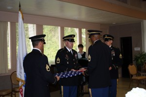 Dee J. Valentine's birthday felt like a living memorial service with the Color Guard folding a flag to commemorate his service in World War II and the Korean War. Photo Courtesy of Michele Miller