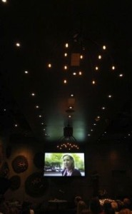"""A life story video about author Denise Carson's life titled """"Coming Full Circle"""" by Jay Gianukos is shown at her book release party at AnQi restaurant. The book is titled """"Parting Ways: New Rituals and Celebrations of Life's Passing."""" CHRISTINE COTTER, FOR THE ORANGE COUNTY REGISTER"""