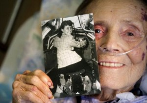Pat White, 89, holds a 1930s picture of herself in the tail-gunner seat of a then-new B-17. She was one of the few women photojournalists in a male-dominated field. White got along well with the guys and found them helpful. She later was a photographer with Douglas Aircraft during the war. CINDY YAMANAKA, THE ORANGE COUNTY REGISTER
