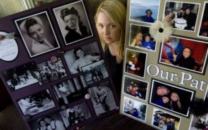 Elizabeth Carroll of Laguna Beach is framed by images of her grandma's life. Images of Carroll, her husband and grandma on their world travels are included, bottom right. The posters were featured at White's memorial reception. CINDY YAMANAKA, THE ORANGE COUNTY REGISTER