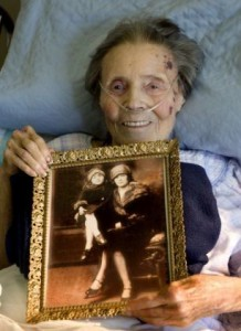 at White, 89, of Mission Viejo, holds a 1925 photo of her mom, Helen, and herself, both wearing fur coats. She grew up in the Shelton Gang in Illinois. After school at Long Beach Poly Tech, she'd water taxi to her uncle's ship, a floating casino, three miles offshore of Long Beach, where she'd play roulette and eat dinner on board. CINDY YAMANAKA, THE ORANGE COUNTY REGISTER