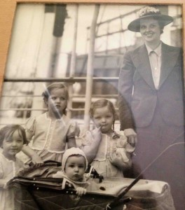 Lois Bechtle at 10 months old with her mother and three sisters boarding a ship to Pasto, Columbia.