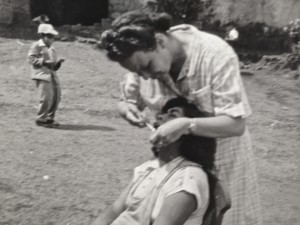 Señora Katherine, Lois Bechtle's mother, treating a patient in Columbia.